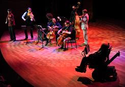 Cellist Yo-Yo Ma and the Silk Road Ensemble perform for British physicist Stephen Hawking, right, at the 2010 World Science Festival opening night gala performance at Alice Tully Hall on Wednesday, June 2, 2010 in New York.