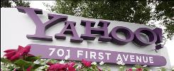 In this 2009 file photo, a sign outside Yahoo headquarters in Sunnyvale, Calif. is shown. Yahoo is making changes to its site this week, which includes a partnership with Facebook.