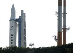 The Korea Space Launch Vehicle-1, South Korea's second space rocket, sits on its launch pad at the Naro Space Center in Goheung, South Korea, Wednesday. South Korea's space program suffered a setback as officials believe the two-stage  rocket operated normally for 137 seconds after liftoff from the country's space center. But then communications with the rocket were lost.
