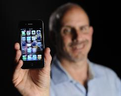 USA TODAY's Ed Baig with the iPhone 4.