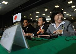 The head of the Japanese delegation, Yasue Funayama (R), waits on June 21, 2010 for the opening of the International Whaling Commission (IWC) meeting in Agadir. The IWC is to debate catch quotas, which could replace a moratorium. The 88-nation body will debate the proposal, put forward by the IWC's chairmen in an attempt to break a 24-year deadlock that has nearly wrecked the global whaling regime.