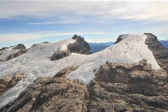 This photo released by Papua Project Freeport-McMoRan shows glaciers on Puncak Jaya, mountains in eastern Indonesia. Lonnie Thompson, one of the world's most accomplished glaciologists, said the glaciers are dying after wrapping up a 13-day trip to Puncak Jaya, rarely visited even by local tribesman.