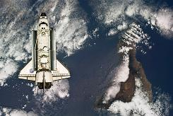 The space shuttle Atlantis approaches the International Space Station during rendezvous and docking operations on May 16, 2010.
