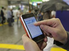 In this June 14, 2010 photo, Daisuke Tsuda tweets with his mobile phone at a station in Tokyo. Although still behind Internet-connected countries such as Japan, South Korea and parts of Europe, the number of Americans accessing the Internet on their cellphones is increasing.