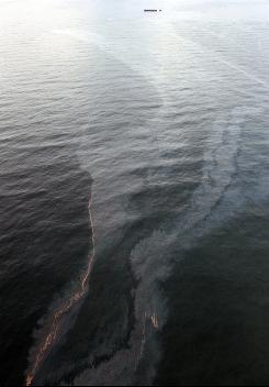 A huge oil slick approaches the beach in Gulf Shores, Ala., Friday, July 2, 2010. The Deepwater Horizon disaster is just one of many technological disasters that happened because of arrogance and hubris.