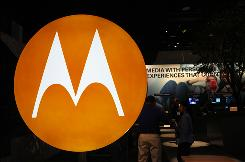 In this 2010 photo, the Motorola logo is seen at the company's exhibit at the Consumer Electronics Show in Las Vegas. Motorola said July 19, 2010, that it is selling most of its wireless network division to Nokia Siemens Networks, a Finnish-German joint venture, for $1.2 billion as part of a planned breakup of the company.