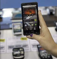 Best Buy customer looks at a Droid smartphone from Verizon in Mountain View, Calif. Smartphones are increasingly becoming targets for cybercriminals.