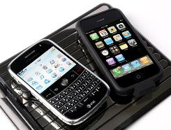 Pictured is a WildCharger Pad with a BlackBerry, left, and an iPhone on top of it. Chris Paget demonstrated how phones using GSM can be intercepted; however, phones using 3G or 4G networks, like the iPhone, or that apply encryption to calls, like the BlackBerry, can foil the attack.