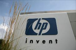The HP logo is displayed on the entrance to the Hewlett-Packard Headquarters September 16, 2008 in Palo Alto, California. HP has reached a settlement with the Department of Justice concerning a 2007 case alleging violations of the False Claims Act.