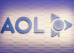 In this 2008 photo, the America Online logo is seen at the AOL booth at the Consumer Electronics Show in Las Vegas. Internet company AOL said Wednesday that a $1.4 billion accounting charge pushed the company to a $1 billion-plus net loss in the second quarter.