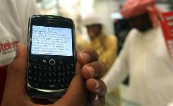 A BlackBerry user displays a text message sent by his service provider notifying him of the suspension of services, at a mobile shop in Dubai, United Arab Emirates. Saudi Arabia had also considered suspending BlackBerry services, but changed its mind after 'positive developments' in talks with maker Research in Motion.