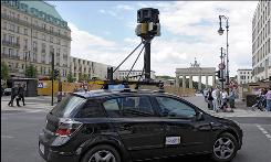 In this July 9, 2008 file photo a google street view car drives near the Brandenburg Gate in Berlin, Germany.