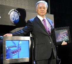 Toshiba executive Masaaki Osumi unveils the world's first 3D television that does not require viewers to wear special glasses, called the 'Regza GL1 Series,' during a preview at Ceatec, Asia's largest electronics trade show in Tokyo.