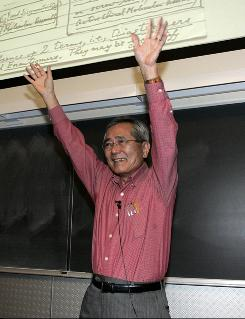 Chemistry professor Ei-ichi Negishi reacts to applause from his chemistry class before beginning a lecture shortly after he was awarded a share in the Nobel Prize for Chemistry on Wednesday in West Lafayette, Ind.