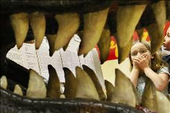 Warrensburg-Latham Elementary School student Brieana Chambers clinches her mouth as she arrives at the exhibit of a T-Rex dinosaur skull as part of the Dino Discovery program at her school Thursday Feb. 7, 2007.
