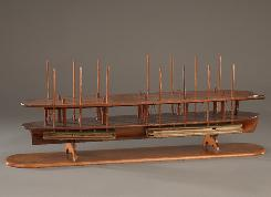 Abraham Lincoln's patent model for a method of lifting boats over shoals.