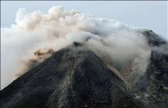 The Merapi volcano spews thick smoke near Glagaharjo village in Sleman, Yogyakarta, Indonesia on October 26, 2010.