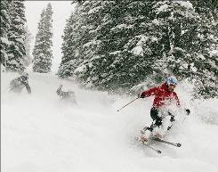 U.S. ski racers Stacey Cook, Leanne Smith and Hailey Duke, ski powder snow on Friday, Dec.7, 2007 in Aspen, Colo.