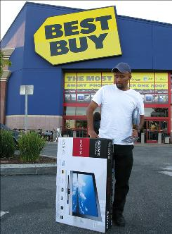 ORG XMIT: CADD105 Benjamin Lopez brings home a new Sony LCD Digital Color television at the Best Buy store  Monday, Sept. 13, 2010, in Glendale, Calif.