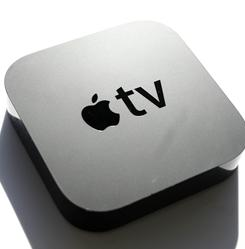 The Apple TV device grabs movies and TV show rentals from the Internet and displays them on a TV. It has both Wi-Fi and Ethernet connectivity.
