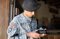 Sgt. Willie LeBeouf from Houston, Texas, assigned to the 5th Brigade, 1st Armored Division, Army Evaluation Task Force, selects a local map to display on a smart phone. The phone was loaded with a special application to help Soldiers interview local residents during a battle scenario as part of an exercise.