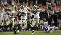 In this Feb. 7, 2010 file photo, New Orleans Saints cornerback Tracy Porter (22) reacts as he returns an interception for a touchdown against the Indianapolis Colts during the NFL Super Bowl game .
