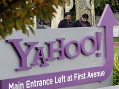Workers leave a Yahoo headquarters building in Sunnyvale, Calif. earlier this month.