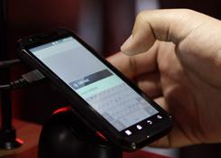 A buyer tests Motorola's Droid Bionic 4G phone at the Consumer Electronics Show in Las Vegas.