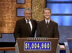 "In this 2004 photo, software developer Ken Jennings poses with Jeopardy host Alex Trebek. Jennings, who won a record 74 consecutive ""Jeopardy!"" games in 2004-05, is going to take on the IBM hardware and software system named Watson in a practice round along with Brad Rutter, who won a record $3,255,102 in prize money."