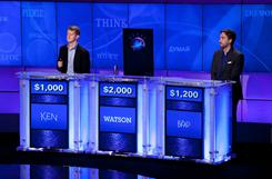 Contestants Ken Jennings, left, and Brad Rutter, right, compete against 'Watson' in a practice round of 'Jeopardy!'
