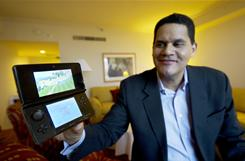 Reggie Fils-Aime, President and COO of Nintendo USA, displays the company's new 3D portable gaming system, the $250 Nintendo 3DS, at the recent Consumer Electronics Show. It will be released on March 27.