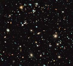 "The recently discovered galaxy ""UDFj-39546284"" is a mere speck among thousands of galaxies in this image from the Hubble telescope. It's the deepest image of the sky ever obtained in the near-infrared."