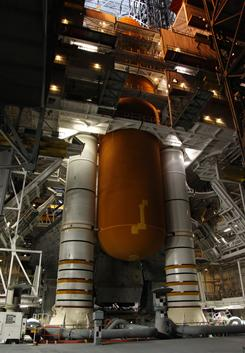 This image provided by NASA shows space shuttle Discovery with its external fuel tank being worked on at NASA's Kennedy Space Center in Florida.