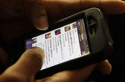 An iPhone user accesses his Twitter account. As social media toys such as Twitter, Facebook and YouTube open more lines of communication, more people might find themselves overwhelmed by all the information.