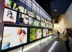 A wall of LG TVs on display at January's Consumer Electronics show in Las Vegas. Annual TV sales are sluggish for the first time since digital TVs hit the market in 2005.