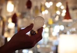 Manager Nick Reynoza holds a 100-watt incandescent light bulb at Royal Lighting in Los Angeles.
