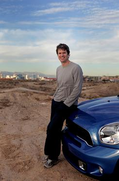 "Tim Westergren, co-founder of Pandora, in the Nevada desert with a Mini car featuring the ""Mini-Connected"" add-on that lets you plug in your smart phone and bring Internet apps to the car, including Pandora."