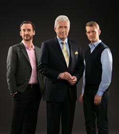 This photo courtesy of IBM shows contestant Brad Rutter, Jeopardy host Alex Trebek and contestant Ken Jennings. The first-ever man vs. machine Jeopardy! competition began airing on Monday.