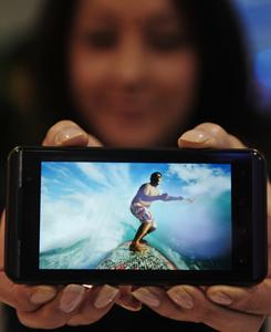 """LG Electronics on Monday demonstrated it """"Optimus 3D"""" phone with a 3-D screen and a 3-D camera, set to go on sale later this spring."""