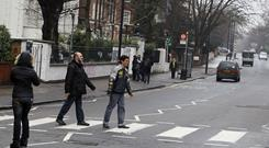 Tourists cross over the zebra crossing in Abbey Road in London. Websites such as Gogobot, Afar Connect, Bonvoy, and Vacation Relation seek to connect like-minded travelers for sharing tips and recommendations.