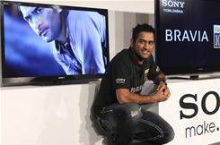 Indian cricket captain Mahendra Singh Dhoni poses during a promotional event of Sony's Bravia TVs in Mumbai, India. Sony currently has the number one market share in flat-panel TVs, digital cameras, home theaters, and camcorders in India.