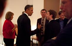 President Obama talks with Facebook CEO Mark Zuckerberg before a dinner with technology business leaders in Woodside, Calif.