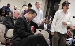 New York City Comptroller John Liu takes notes at a public meeting to suggest audits for his office.  Cities around the country are trying use technology to harness the wisdom of citizens and create virtual civic forums.