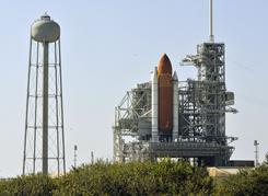 The space shuttle Discovery sits Wednesday morning on launch pad 39-A while preparations for the Thursday launch continue.