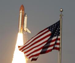 Space shuttle Discovery lifts off at the Kennedy Space Center. The crew of six astronauts are on an 11-day mission to the international space station.