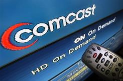 In this Aug. 6, 2009 file photo, the Comcast logo is displayed on a TV set in North Andover, Mass.