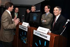 In this photo provided by IBM, Dr. Eric Brown, left, from IBM Research preps members of congress: Jared Polis (D-Colo.), second left, Bill Cassidy (R-La.), center, Jim Himes (D-Conn.), second right, and Rush Holt (D-N.J.) for an exhibition game against IBM's Watson.
