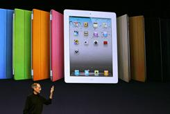 Apple CEO Steve Jobs speaks about the new case protector during Apple's unveiling of the new iPad 2.
