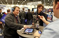 Jered Taylor and Carter Alldredge at the Macworld show in January. Upgrading headphones can improve sound on your MP3 player, smartphone or other mobile device.