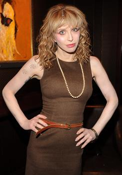 "Singer Courtney Love attends a screening of ""Due Date"" on November 1, 2010 in New York City. She has reportedly reached a settlement, in what would have been the first high profile case possibly defining what constitutes defamation on Twitter, regarding a lawsuit brought against her by fashion designer, Dawn Simorangkir, for allegedly defamatory Twitter messages Love posted in 2009. Love will pay $430,000 in a series of payments stretching out until 2014."